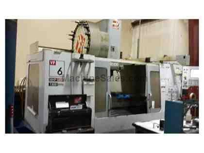 "Haas VF6/50 (2005): 64"" x 32"" x 30"", Side Mounted ATC, Cat 5"