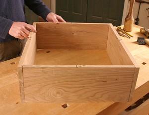 man assembling a cabinet