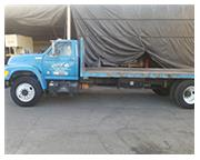 Ford # F700 , 185, 059 miles, auto., flat bed truck, 8 cyl., fwd drive, 8' x 20' bed, 1996