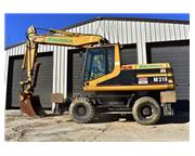 1998 CATERPILLAR M318 MOBILE EXCAVATOR - E6976