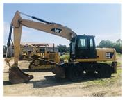 2011 CATERPILLAR M318 D W/ PLUMBING ON STICK W/ CAB W/ A/C & HEAT E7104