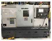 Okuma Captain L470, OSP-P100, 15″ Chuck, 2006, Chip Conveyor