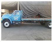 Ford #F700, 185, 059 miles, automatic, flat bed truck, 8 cyl., FWD drive, 8' x 20' bed, 19